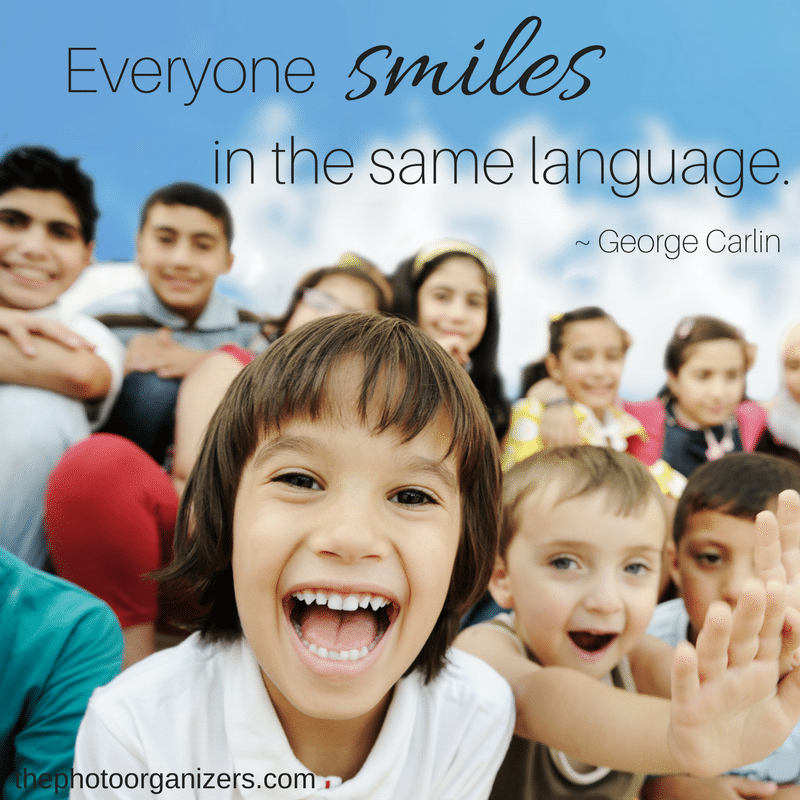 Everyone smiles in the same language. ~ George Carlin | ThePhotoOrganizers.com